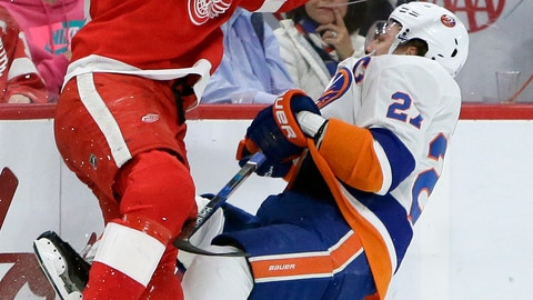 <p>               Detroit Red Wings defenseman Niklas Kronwall (55), of Sweden, checks New York Islanders left wing Anders Lee (27) during the first period of an NHL hockey game Saturday, Dec. 8, 2018, in Detroit. (AP Photo/Duane Burleson)             </p>