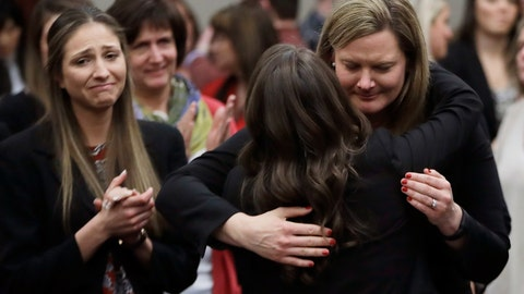 <p>               FILE -In this Jan. 24, 2018, file photo, victims react and hug Assistant Attorney General Angela Povilaitis after Larry Nassar was sentenced by Judge Rosemarie Aquilina to 40 to 175 years in prison during a sentencing hearing in Lansing, Mich. (AP Photo/Carlos Osorio, File)             </p>
