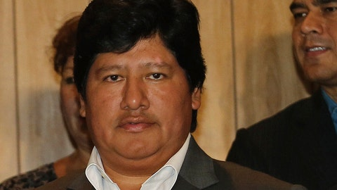<p>               FILE - In this March 2, 2015 file photo, Peru's Football Federation President Edwin Oviedo poses for a photo during a press conference in Lima, Peru. Oviedo was arrested, Thursday, Dec. 6, 2018, a few months after leading his country back to the World Cup for the first time in 36 years. Prosecutors say he will be held initially for 15 days as they investigate his alleged connections to a criminal network that paid for several judges to attend the World Cup in Russia. (AP Photo/Fernando Sangama, File)             </p>