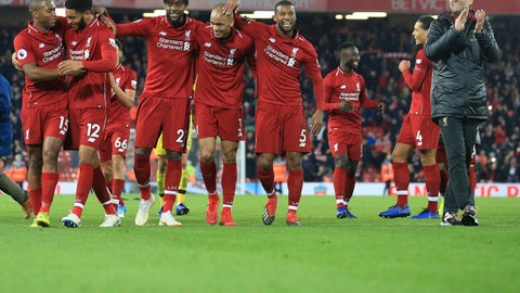 <p>               Liverpool coach Juergen Klopp, right, celebrates after Liverpool forward Divock Origi, third from left, scored his side's first goal at the end of the English Premier League soccer match between Liverpool and Everton at Anfield Stadium in Liverpool, England, Sunday, Dec. 2, 2018. (AP Photo/Jon Super)             </p>