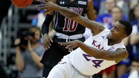 <p>               Kansas' Lagerald Vick (24) passes the ball during the second half of the team's NCAA college basketball game against New Mexico State on Saturday, Dec. 8, 2018, in Kansas City, Mo. Kansas won 63-60. (AP Photo/Charlie Riedel)             </p>