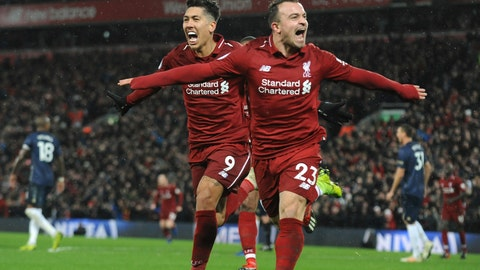 <p>               Liverpool's Xherdan Shaqiri, right, celebrates after scoring his side's third goal during the English Premier League soccer match between Liverpool and Manchester United at Anfield in Liverpool, England, Sunday, Dec. 16, 2018. (AP Photo/Rui Vieira)             </p>