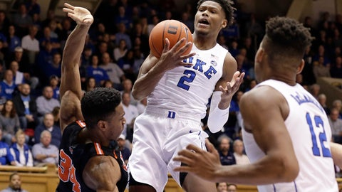 <p>               Duke's Cam Reddish (2) grabs the ball over Princeton's Richmond Aririguzoh (34) as Duke's Javin DeLaurier (12) watches at right during the first half of an NCAA college basketball game in Durham, N.C., Tuesday, Dec. 18, 2018. (AP Photo/Gerry Broome)             </p>