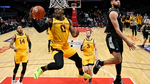 <p>               FILE - In this Friday, Dec. 7, 2018, file photo, Arizona State guard Luguentz Dort, second from left, shoots as Nevada forward Caleb Martin, right, defends during the first half of an NCAA college basketball game in Los Angeles. At 6-foot-4, 215 pounds, he's built like linebacker on the Arizona State football team, not some scrawny teenager disdainfully bumped out of the lane on a basketball court. (AP Photo/Mark J. Terrill, File)             </p>