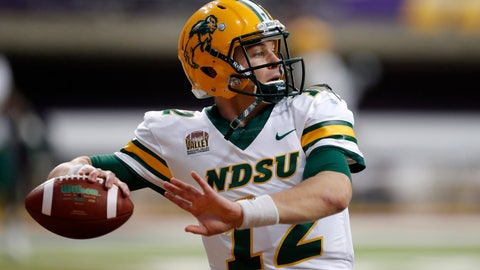 <p>               FILE - In this Saturday, Oct. 6, 2018, file photo, North Dakota State quarterback Easton Stick warms up before an NCAA college football game against Northern Iowa, in Cedar Falls, Iowa. North Dakota State quarterback Easton Stick was one of three Bison players selected to The Associated Press FCS All-America team, Tuesday, Dec. 11, 2018. (AP Photo/Charlie Neibergall, File)             </p>