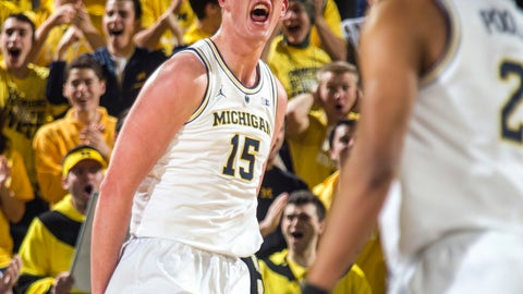 <p>               Michigan center Jon Teske (15) celebrates his basket in the first half of an NCAA college basketball game against Purdue at Crisler Center in Ann Arbor, Mich., Saturday, Dec. 1, 2018. (AP Photo/Tony Ding)             </p>