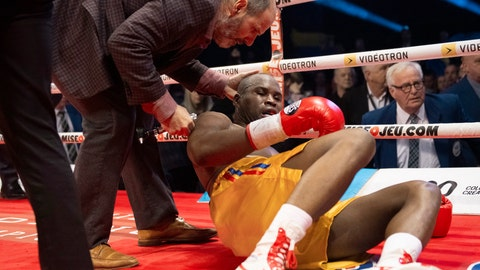 <p>               Ring doctor Marc Gagne, left, checks on Adonis Stevenson, of Canada, after he was knocked out by Oleksandr Gvozdyk, of Ukraine, in their light heavyweight WBC championship boxing fight, Saturday, Dec. 1, 2018, in Quebec City. (Jacques Boissinot/The Canadian Press via AP)             </p>