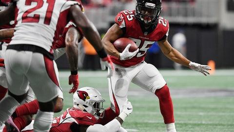 <p>               Atlanta Falcons running back Ito Smith (25) runs against the Arizona Cardinals during the first half of an NFL football game, Sunday, Dec. 16, 2018, in Atlanta. (AP Photo/Danny Karnik)             </p>