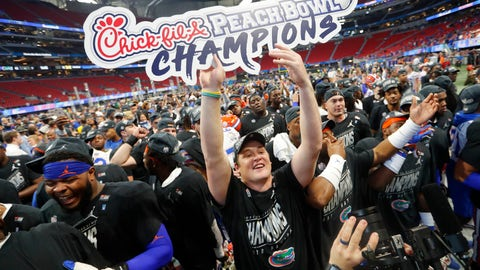 <p>               Florida players celebrate after the Peach Bowl NCAA college football game against Michigan, Saturday, Dec. 29, 2018, in Atlanta. Florida won 41-15. (AP Photo/John Bazemore)             </p>