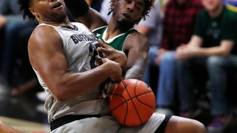 <p>               Colorado forward Evan Battey, left, struggles to hold on to a rebound as Colorado State guard Kris Martin defends in the second half of an NCAA college basketball game Saturday, Dec. 1, 2018, in Boulder, Colo. (AP Photo/David Zalubowski)             </p>