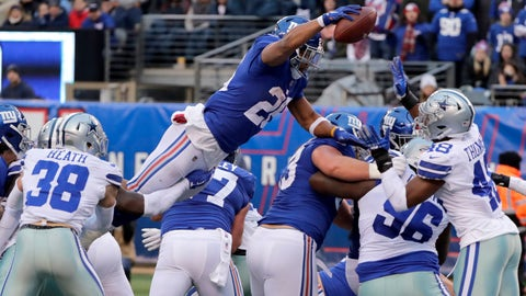 <p>               New York Giants' Saquon Barkley, top, scores a touchdown just before the ball is knocked from his hands during the second half of an NFL football game against the Dallas Cowboys, Sunday, Dec. 30, 2018, in East Rutherford, N.J. (AP Photo/Frank Franklin II)             </p>