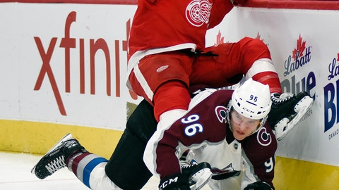 <p>               Detroit Red Wings center Luke Glendening, top, falls atop of Colorado Avalanche right wing Mikko Rantanen (96), of Finland, during the first period of an NHL hockey game in Detroit, Sunday, Dec. 2, 2018. (AP Photo/Jose Juarez)             </p>