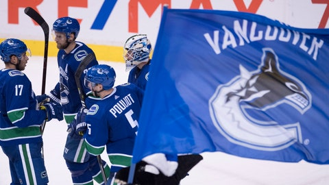 <p>               Vancouver Canucks goaltender Jacob Markstrom, right, and teammates celebrate the team's win over the St. Louis Blues in an NHL hockey game Thursday, Dec. 20, 2018, in Vancouver, British Columbia. (Jonathan Hayward/The Canadian Press via AP)             </p>