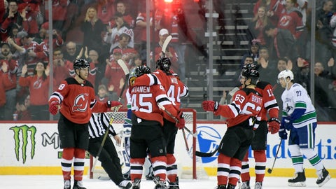 <p>               New Jersey Devils left wing Miles Wood (44) celebrates his goal with Drew Stafford (18), Sami Vatanen (45), Jesper Bratt (63) and Nico Hischier (13) during the first period of an NHL hockey game Monday, Dec. 31, 2018, in Newark, N.J. (AP Photo/Bill Kostroun)             </p>