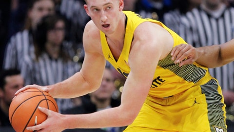 <p>               FILE - In this Jan. 6, 2018, file photo, Marquette guard Sam Hauser controls the ball during an NCAA college basketball game against Villanova in Philadelphia. The play of brothers Sam and Joey Hauser have helped 20th-ranked Marquette navigate some early nonconference tests to get off to an 8-2 start. (AP Photo/Laurence Kesterson, File)             </p>