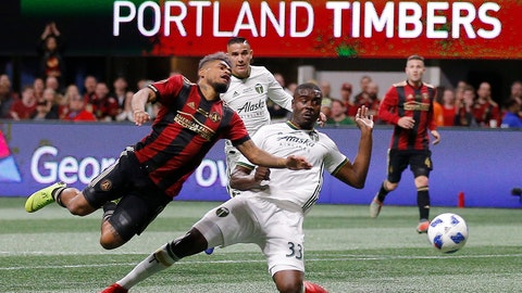 <p>               Atlanta United forward Josef Martinez (7) and Portland Timbers defender Larrys Mabiala (33) fight for the ball during the first half of the MLS Cup championship soccer game, Saturday, Dec. 8, 2018, in Atlanta. (AP Photo/Todd Kirkland)             </p>