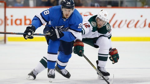 <p>               Minnesota Wild's Eric Staal (12) defends against Winnipeg Jets' Jack Roslovic (28) during second period NHL action in  Winnipeg, Manitoba, on Saturday, Dec. 29, 2018. (John Woods/The Canadian Press via AP)             </p>