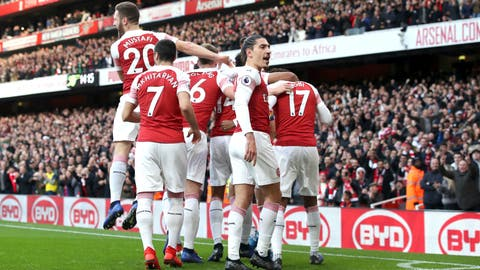 <p>               Arsenal's Pierre-Emerick Aubameyang celebrates scoring his side's first goal of the game from the penalty spot with teammates, as a banana skin is thrown onto the pitch during the English Premier League soccer match at Emirates Stadium, London, Sunday Dec. 2, 2018. A Tottenham supporter was arrested for throwing a banana skin onto the field after Aubameyang scored and celebrated in front of away fans. (Nick Potts/PA via AP)             </p>