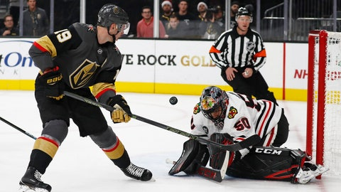 <p>               Chicago Blackhawks goaltender Corey Crawford (50) blocks a shot by Vegas Golden Knights right wing Reilly Smith (19) during the second period of an NHL hockey game Thursday, Dec. 6, 2018, in Las Vegas. (AP Photo/John Locher)             </p>