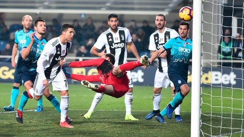 <p>               Juventus' Cristiano Ronaldo, third from left, scores his side's second goal during the Serie A soccer match between Atalanta and Juventus in Bergamo, Italy, Wednesday,  Dec. 26, 2018. (Paolo Magni/ANSA via AP)             </p>