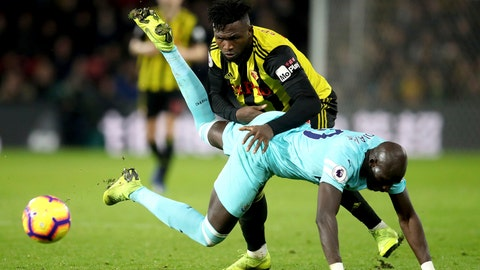 <p>               Newcastle United's Mohamed Diame falls under pressure from Watford's Isaac Success, during their English Premier League soccer match, at Vicarage Road in Watford, London, Saturday Dec. 29, 2018. (Adam Davy/PA via AP)             </p>