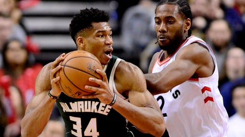 <p>               Toronto Raptors forward Kawhi Leonard (2) puts pressure on Milwaukee Bucks forward Giannis Antetokounmpo (34) as he looks for the pass during second half NBA basketball action in Toronto on Sunday, Dec. 9, 2018. (Frank Gunn/The Canadian Press via AP)             </p>