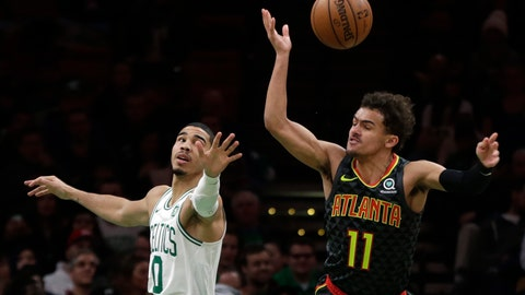 <p>               Atlanta Hawks guard Trae Young (11) is fouled as he goes to the hoop against Boston Celtics forward Jayson Tatum (0) in the second quarter of an NBA basketball game, Friday, Dec. 14, 2018, in Boston. (AP Photo/Elise Amendola)             </p>