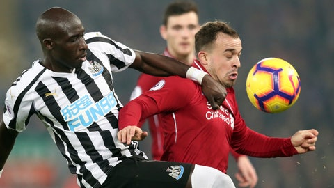 <p>               Newcastle's Mohamed Diame, left, and Liverpool's Xherdan Shaqiri vie for the ball during the English Premier League soccer match between Liverpool and Newcastle at Anfield Stadium, Liverpool, England, Wednesday, Dec. 26, 2018. (AP Photo/Jon Super)             </p>