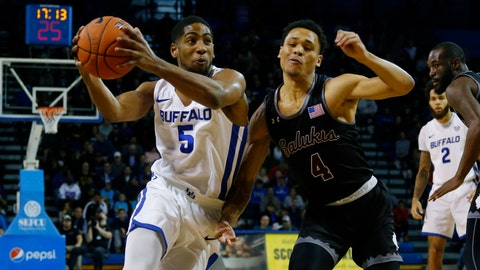 <p>               Buffalo guard CJ Massinburg (5) drives past Southern Illinois guard Eric McGill (4) during the first half of an NCAA college Basketball game, Saturday, Dec. 15, 2018, in Buffalo N.Y. (AP Photo/Jeffrey T. Barnes)             </p>