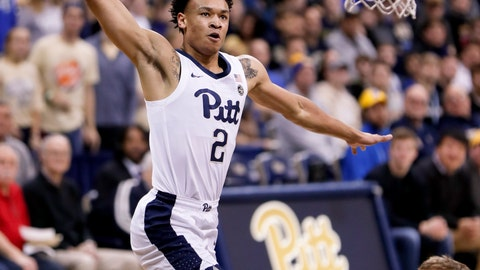 <p>               Pittsburgh's Trey McGowens (2) goes past Colgate's Tucker Richardson (15) to dunk during the first half of an NCAA college basketball game, Saturday, Dec. 29, 2018, in Pittsburgh. (AP Photo/Keith Srakocic)             </p>