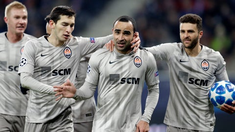 <p>               Shakhtar defender Ismaily Ismaily, center right, celebrates with teammates after scoring his side's opening goal during the group F Champions League soccer match between Hoffenheim and Shakhtar Donetsk at the Rhein-Neckar-Arena stadium in Sinsheim, Germany, Tuesday, Nov. 27, 2018. (AP Photo/Michael Probst)             </p>
