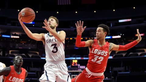 <p>               Saint Mary's guard Jordan Ford, center, shoots as New Mexico forward Makuach Maluach, left, and guard Anthony Mathis defend during the first half of an NCAA college basketball game at the Air Force Reserve Classic on Friday, Dec. 7, 2018, in Los Angeles. (AP Photo/Mark J. Terrill)             </p>
