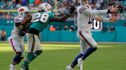 <p>               Buffalo Bills quarterback Josh Allen (17) runs the ball as Miami Dolphins cornerback Bobby McCain (28) attempts to tackle, during the second half of an NFL football game, Sunday, Dec. 2, 2018, in Miami Gardens, Fla. (AP Photo/Lynne Sladky)             </p>