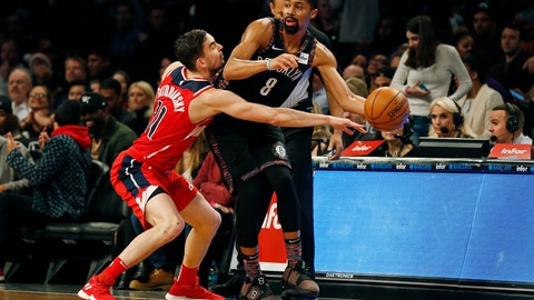 <p>               Brooklyn Nets guard Spencer Dinwiddie (8) looks to pass around Washington Wizards guard Tomas Satoransky during the first half of an NBA basketball game Friday, Dec. 14, 2018, in New York. (AP Photo/Adam Hunger)             </p>