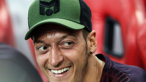 <p>               FILE - In this Thursday, July 26, 2018 file photo, Arsenal's Mesut Ozil smiles on the bench during the International Champions Cup match between Arsenal and Atletico Madrid in Singapore. Mesut Ozil is becoming an issue for Arsenal and new coach Unai Emery. Ozil's style of play doesn't seem to suit the high-energy approach of Emery and the club's board has a big decision to make on Arsenal's marquee player in the upcoming transfer window. (AP Photo/Yong Teck Lim, File)             </p>