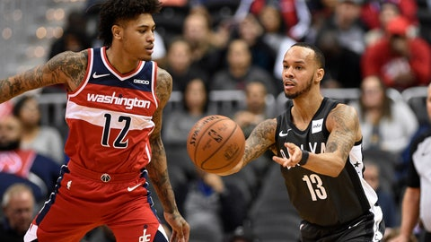 <p>               Brooklyn Nets guard Shabazz Napier (13) passes the ball past Washington Wizards forward Kelly Oubre Jr. (12) during the first half of an NBA basketball game Saturday, Dec. 1, 2018, in Washington. (AP Photo/Nick Wass)             </p>