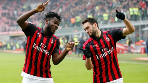 <p>               AC Milan's Franck Kessie, left, celebrates with his teammate Hakan Calhanoglu after scoring his side's second goal during the Serie A soccer match between AC Milan and Parma at the San Siro Stadium, in Milan, Italy, Sunday, Dec. 2, 2018. (AP Photo/Antonio Calanni)             </p>