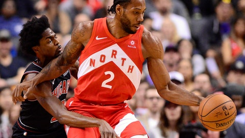 <p>               Toronto Raptors forward Kawhi Leonard (2) dribbles the ball as Chicago Bulls forward Justin Holiday (7) defends during first-half NBA basketball game action in Toronto, Ontario, Sunday, Dec. 30, 2018. (Frank Gunn/The Canadian Press via AP)             </p>