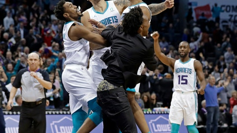 <p>               Charlotte Hornets' Jeremy Lamb, jumping right, celebrates with teammates Malik Monk, left, Willy Hernangomez, center and Devonte' Graham, front, as Kemba Walker (15) celebrates in background after Lamb's go-ahead and eventual game-winning basket against the Detroit Pistons in the second half of an NBA basketball game in Charlotte, N.C., Wednesday, Dec. 12, 2018. Charlotte won 108-107. (AP Photo/Chuck Burton)             </p>