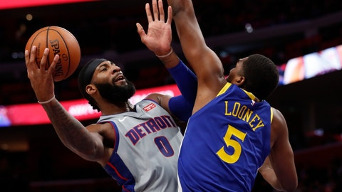 <p>               Detroit Pistons center Andre Drummond (0) shoots as Golden State Warriors forward Kevon Looney (5) defends during the first half of an NBA basketball game, Saturday, Dec. 1, 2018, in Detroit. (AP Photo/Carlos Osorio)             </p>