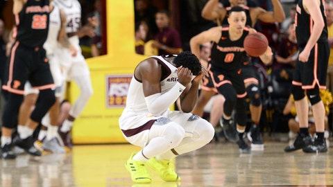 Dec 29, 2018; Tempe, AZ, USA; Arizona State Sun Devils guard Luguentz Dort (0) reacts as Princeton Tigers players celebrate after the game at Wells Fargo Arena (AZ). Mandatory Credit: Joe Camporeale-USA TODAY Sports
