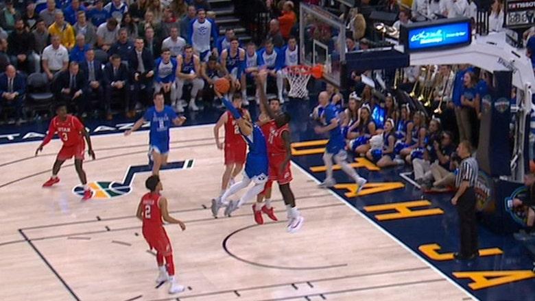 BYU's Yoeli Childs throws down vicious dunk against Utah