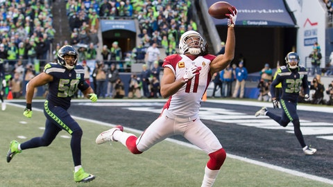 Dec 30, 2018; Seattle, WA, USA; Arizona Cardinals wide receiver Larry Fitzgerald (11) catches a one-handed pass for a touchdown against the Seattle Seahawks during the first half at CenturyLink Field. Mandatory Credit: Steven Bisig-USA TODAY Sports