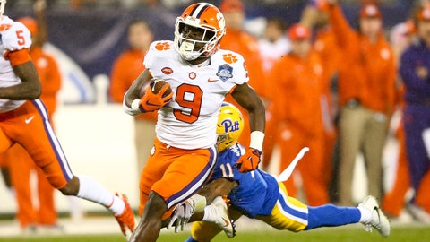 Dec 1, 2018; Charlotte, NC, USA; Clemson Tigers running back Travis Etienne (9) runs the ball in the first quarter against the Pittsburgh Panthers in the ACC championship game at Bank of America Stadium. Mandatory Credit: Jeremy Brevard-USA TODAY Sports