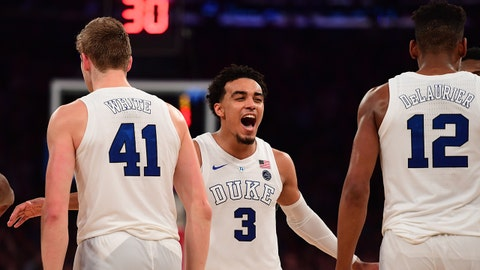 NEW YORK, NEW YORK - DECEMBER 20: Tre Jones #3 of the Duke Blue Devils reacts with teammates Jack White #41 and Javin DeLaurier #12 during the final seconds of the second half of the game against Texas Tech Red Raiders during the Ameritas Insurance Classic at Madison Square Garden on December 20, 2018 in New York City. Duke Blue Devils defeated Texas Tech Red Raiders 69-58. (Photo by Sarah Stier/Getty Images)