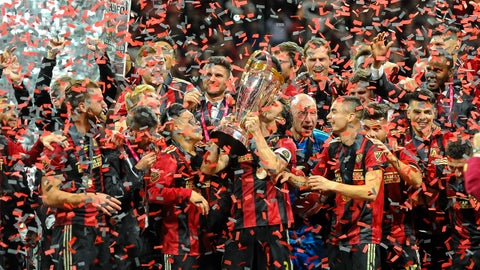ATLANTA, GA - DECEMBER 08: Atlanta United captain Michael Parkhurst (3)  kisses the Major League Soccer Philip F. Anschutz trophy after the MLS Cup Finals match between Atlanta United and Portland Timbers on December 8, 2018 at Mercedes-Benz Stadium in Atlanta, GA.(Photo by John Adams/Icon Sportswire via Getty Images)