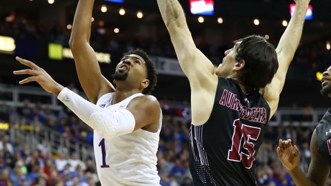 Dec 8, 2018; Kansas City, MO, USA; Kansas Jayhawks forward Dedric Lawson (1) shoots as New Mexico State Aggies forward Ivan Aurrecoechea (15) defends in the first half at Sprint Center. Mandatory Credit: Jay Biggerstaff-USA TODAY Sports