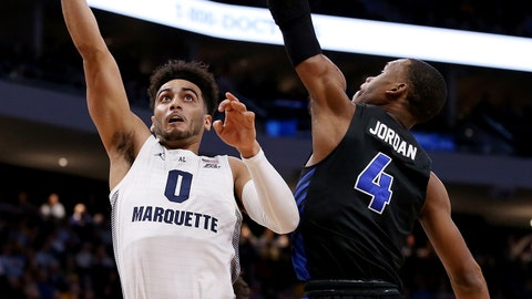 MILWAUKEE, WISCONSIN - DECEMBER 21:  Markus Howard #0 of the Marquette Golden Eagles attempts a shot while being guarded by Davonta Jordan #4 of the Buffalo Bulls in the first half at the Fiserv Forum on December 21, 2018 in Milwaukee, Wisconsin. (Photo by Dylan Buell/Getty Images)