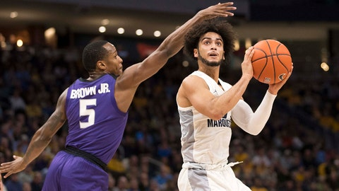 Dec 1, 2018; Milwaukee, WI, USA; Marquette Golden Eagles guard Markus Howard (0) shoots against Kansas State Wildcats guard Barry Brown Jr. (5) during the first half at Fiserv Forum. Mandatory Credit: Jeff Hanisch-USA TODAY Sports