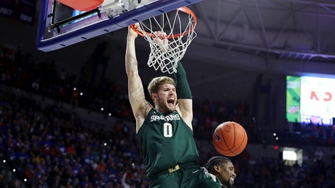 Dec 8, 2018; Gainesville, FL, USA;Michigan State Spartans forward Kyle Ahrens (0) celebrates as he dunks against the Florida Gators during the second half at Exactech Arena. Mandatory Credit: Kim Klement-USA TODAY Sports